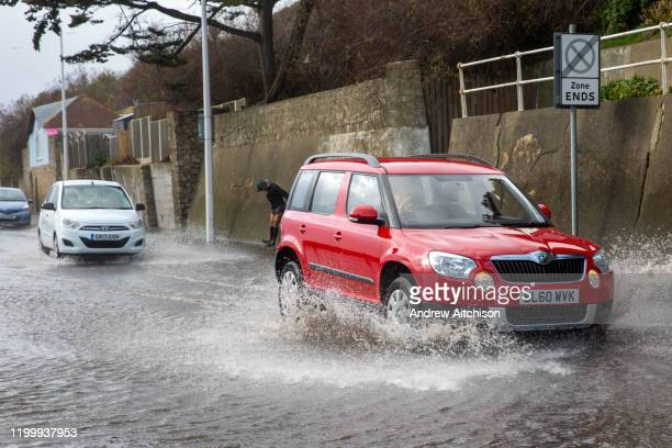 Cars driving down the A259 between Folkestone and Hythe at Sandgate, Kent on the south coast of England, as Storm Ciara continues to sweep over the...