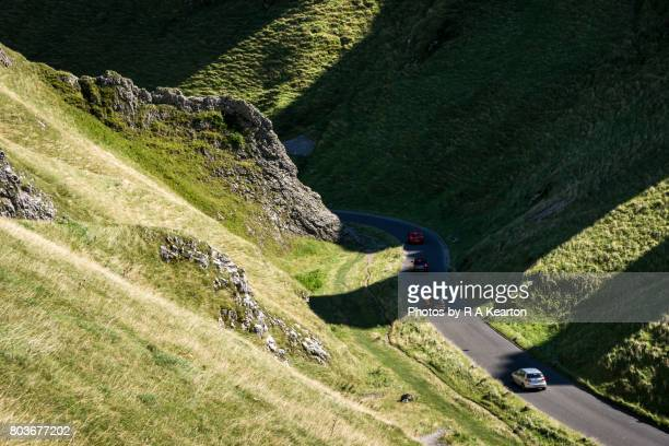 Cars driving down Winnats Pass, Peak District, Derbyshire