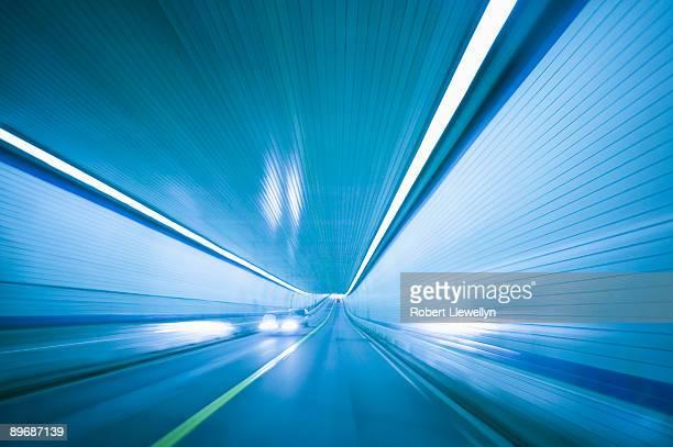 cars driving through chesapeake bay bridge tunnel - chesapeake bay bridge tunnel stock photos and pictures