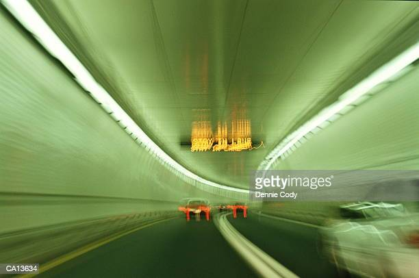 cars driving through tunnel (long exposure) - lincoln tunnel stock photos and pictures