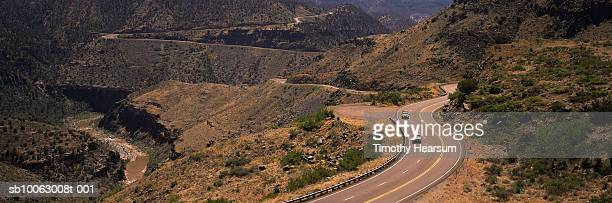 cars driving through winding roads of canyon, salt river on left - timothy hearsum stock pictures, royalty-free photos & images