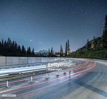 cars driving under starry night in Mount Rainier National Park