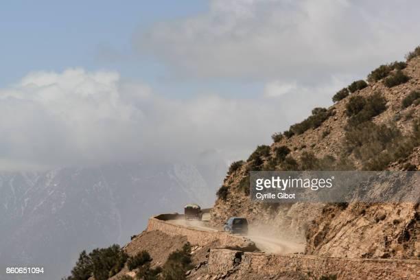 Cars driving up mountain road to Tizi N'Tichka pass