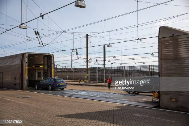 Cars embark the the Eurotunnel train on March 8, 2019 in Folkestone, England. The Eurotunnel rail shuttle is a vital route for commercial traffic...