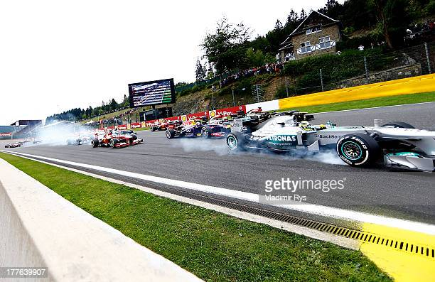 Cars enter the first corner after the start of the Belgian Grand Prix at Circuit de SpaFrancorchamps on August 25 2013 in Spa Belgium