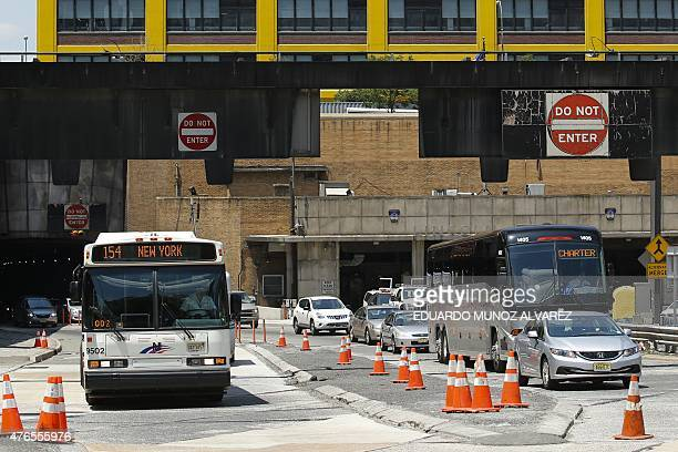 Cars exit the Lincoln Tunnel after a bus accident in the Manhattan bound tube on June 10 2015 in New York Thirtyone people were taken to hospital in...