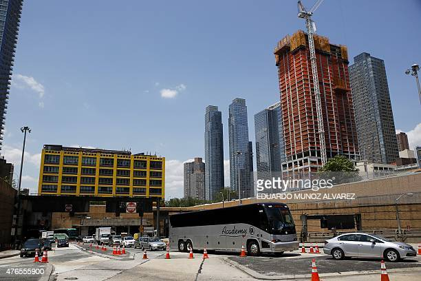 Cars exits the Lincoln Tunnel after two buses were involved in an accident in the Manhattan bound tube on June 10 2015 at Lincoln Tunnel in New York...