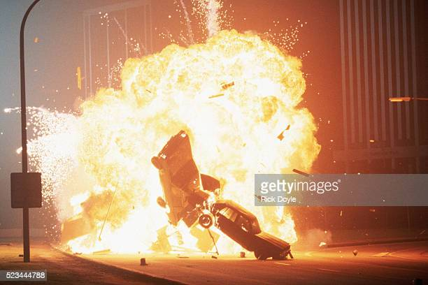 cars exploding in movie stunt - stunt stock pictures, royalty-free photos & images