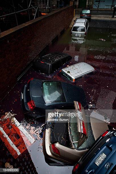 Cars floating in a flooded subterranian basement following Hurricaine Sandy on October 30 2012 in the Financial District of New York United States...