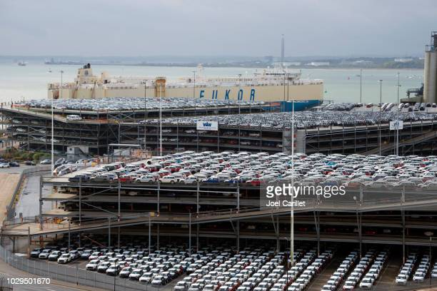 cars for export at shipping dock in southampton, england - prosperity stock photos and pictures