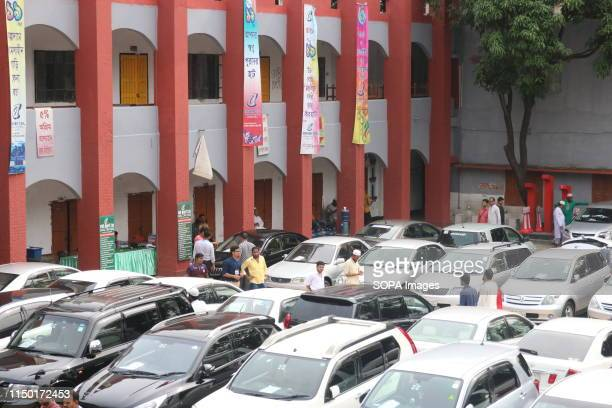 Cars for sale are being parked at the Rajdhani High School ground in Dhaka. A reconditioned car market is being held at the Rajdhani High School...