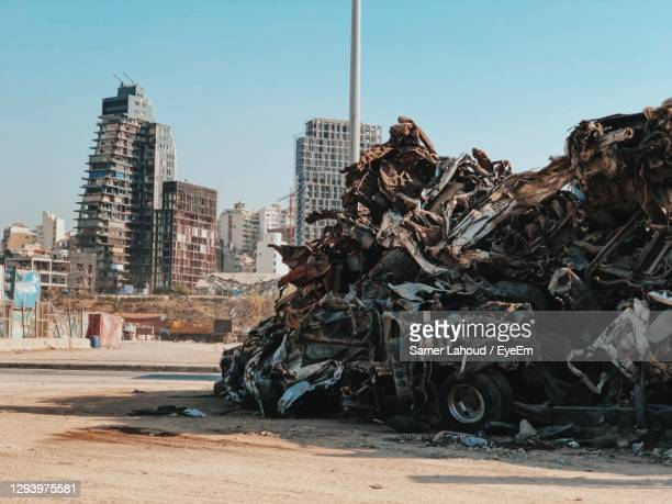 cars from beirut explosion by building in city against sky - beirut stock pictures, royalty-free photos & images