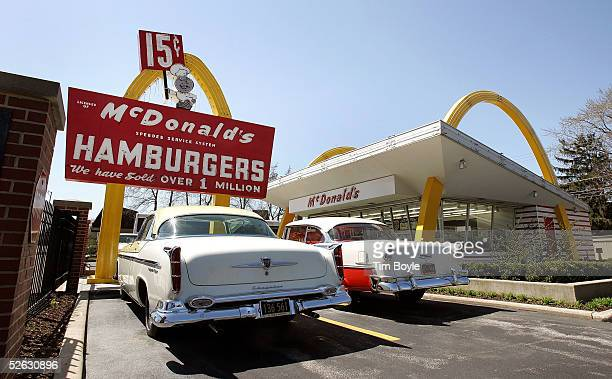 Cars from the 1955era are parked outside McDonald's USA First Store Museum April 14 2005 in Des Plaines Illinois The McDonald's museum is a...