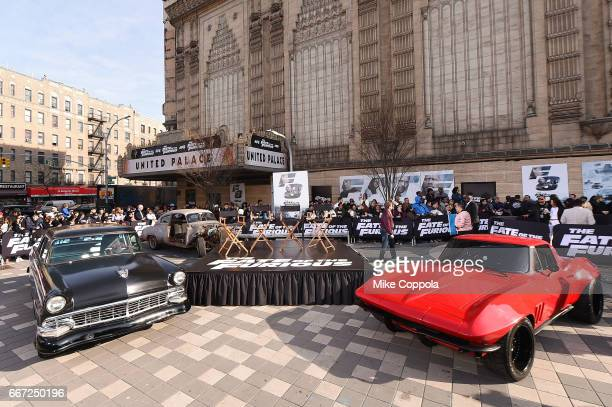 Cars from the movie on display as Vin Diesel and Michelle Rodriguez visit Washington Heights on behalf of The Fate Of The Furious on April 11 2017 in...