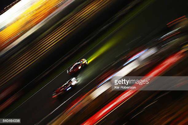 Cars go down the main grandstand straight during practice for the Le Mans 24 Hour race at the Circuit de la Sarthe on June 15 2016 in Le Mans France