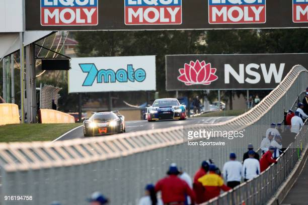 Cars go down the main straight just at sunrise at The LiquiMoly Bathurst 12 Hour Endurance Race held at Mount Panorama Circuit in Bathurst Australia...