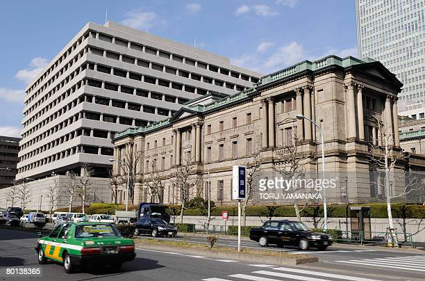 Cars go past the headquarters of the Bank of Japan in Tokyo on March 6, 2008. The Japanese government will nominate a new central bank chief to...