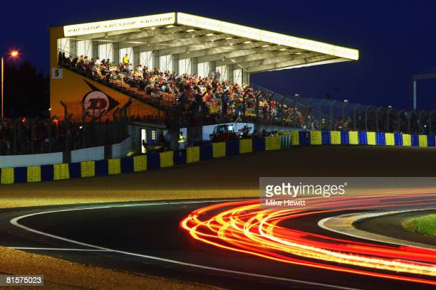 Cars go through the Dunlop Bridge Chicane during the 76th running of the Le Mans 24 Hour race at the Circuit des 24 Heures du Mans on June 14 2008 in...