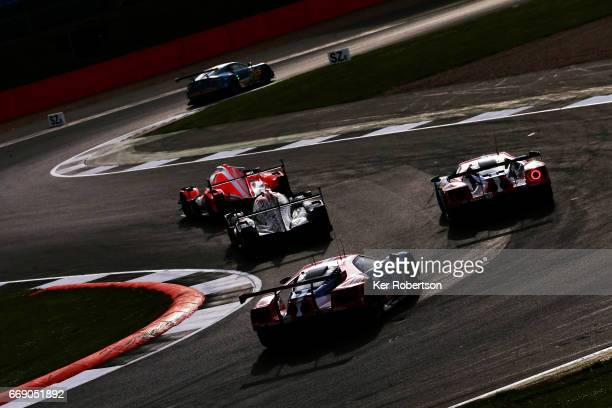 Cars go thru the chicane at Vale during practice for the FIA World Endurance Championship at Silverstone on April 14, 2017 in Northampton, England.