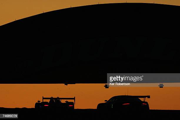 Cars go under the famous Dunlop Bridge at dawn during the 75th running of the Le Mans 24 Hour race at the Circuit des 24 Heures du Mans on June 17...