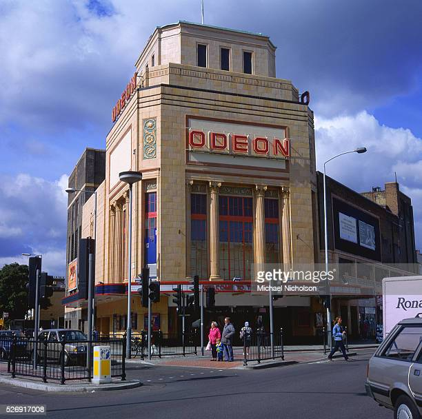 Cars halt at traffic lights outside an Odeon cinema in London England