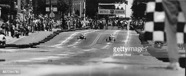 Cars head for finish line checkered flag long lens stacks up distance between the finish line starting block Credit Denver Post