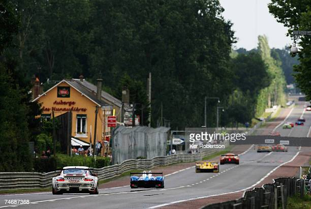 Cars head off down the Mulsanne Straight during the 75th running of the Le Mans 24 Hour race at the Circuit des 24 Heures du Mans on June 16 2007 in...