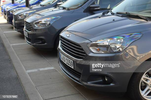 cars in a row on the parking - domestic car stock pictures, royalty-free photos & images
