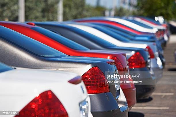 cars in a row - car dealership stock pictures, royalty-free photos & images