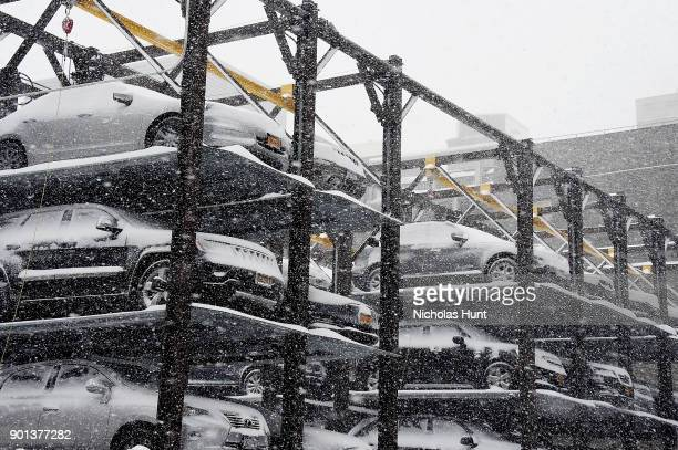 Cars in an elevated parking garage are covered with snow during a massive winter storm on January 4 2018 in New York City As a major winter storm...