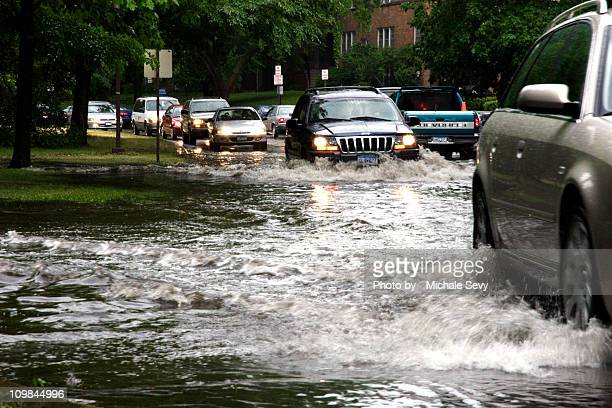 cars in  flood water - flooding stock photos and pictures