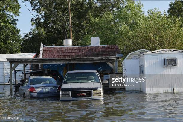 Cars in floodwaters are seen in Nome Texas some 20 miles from Beaumont Texas on August 31 2017 Residents of the US Gulf Coast states of Texas and...