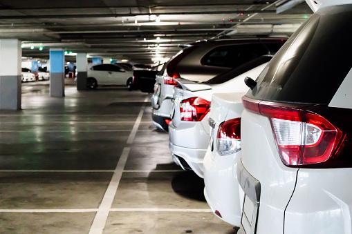 cars in parking garage interior 918642478