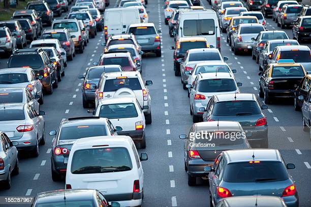 cars in rush hour with traffic at dawn - traffic stock pictures, royalty-free photos & images
