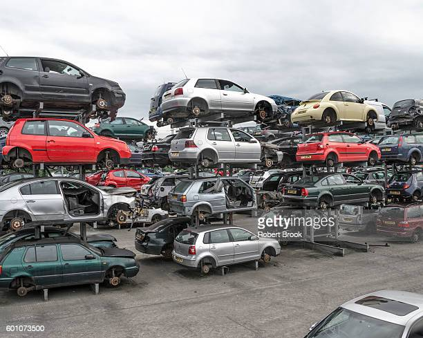 cars in scrap yard - dismantling stock pictures, royalty-free photos & images