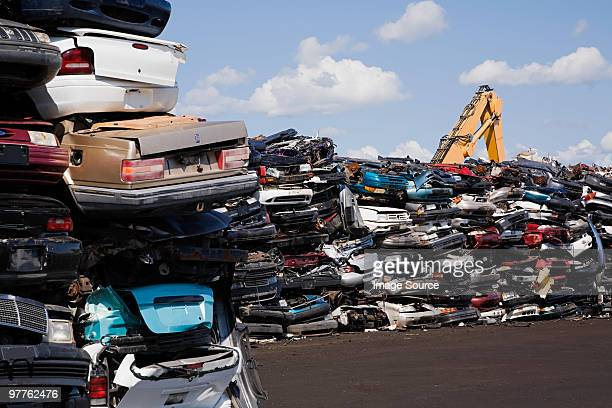 cars in scrap yard - junkyard stock photos and pictures
