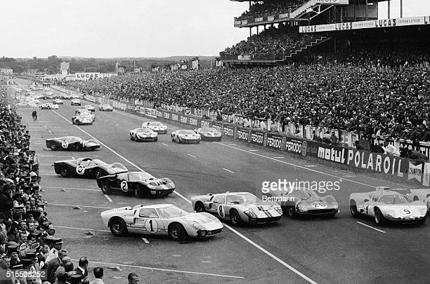 Cars in the 1966 24hour Le Mans race move out onto the track at the start of the race June 18