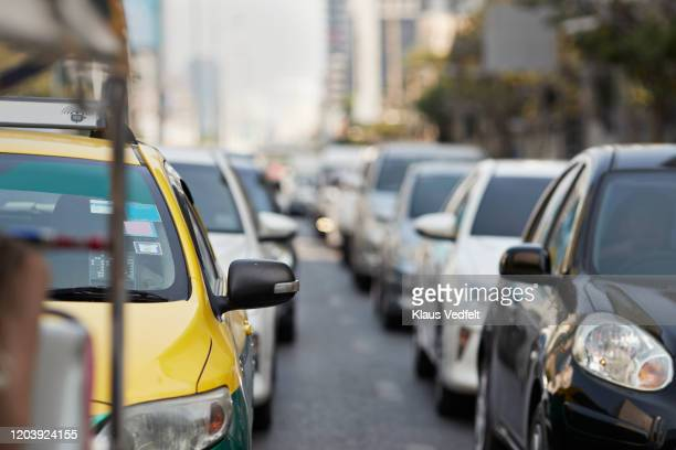 cars in traffic jam during rush hour at city - traffic jam stock pictures, royalty-free photos & images