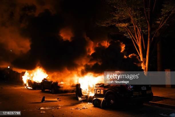 Cars including a police car burn during a protest on May 29 2020 in Atlanta Georgia Demonstrations are being held across the US after George Floyd...