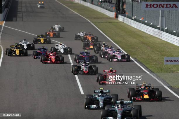 Cars leave the grid at the start of the Formula One Japanese Grand Prix at Suzuka on October 7 2018