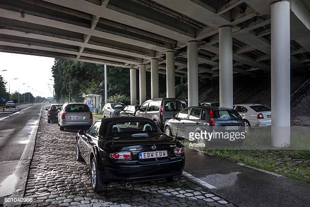 Cars left behind under bridge to shelter for upcoming hail and thunderstorm