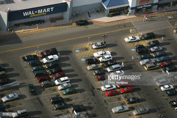 Cars lie in a parking lot of a WalMart Supercenter May 10 2005 in Findlay Ohio WalMart America's largest retailer and the largest company in the...