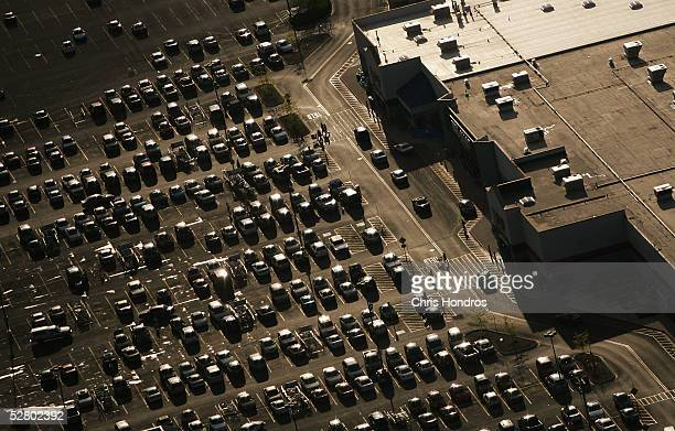 Cars lie in the parking lot of a WalMart as the sun sets May 10 2005 in Bowling Green Ohio WalMart America's largest retailer and the largest company...