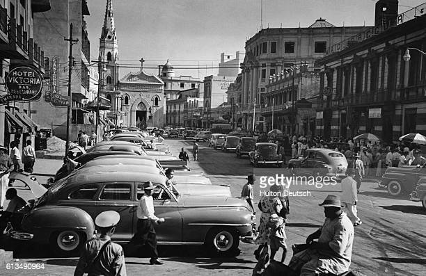 Cars line a wide street overlooked by the Hotel Victoria in central Maracaibo