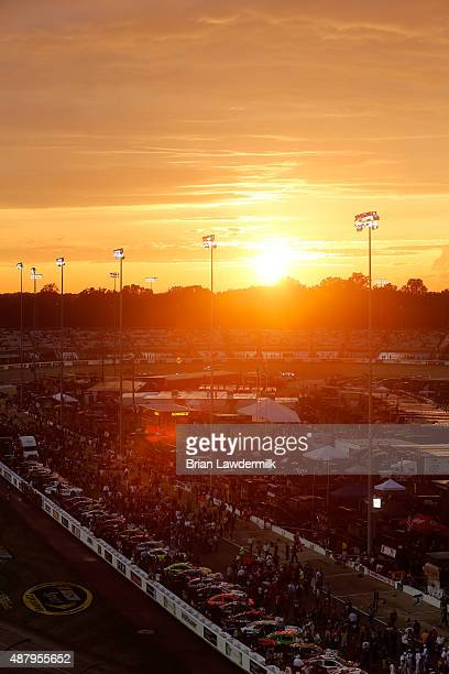 Cars line the grid as the sun sets prior to the NASCAR Sprint Cup Series Federated Auto Parts 400 at Richmond International Raceway on September 12...