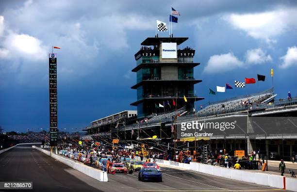 Cars line the grid before it rains during the Monster Energy NASCAR Cup Series Brickyard 400 at Indianapolis Motorspeedway on July 23 2017 in...