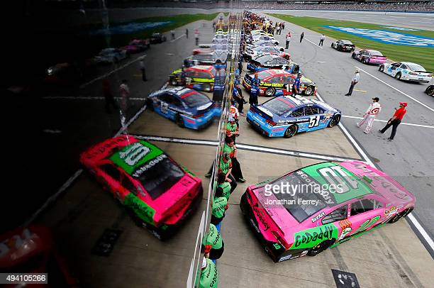 Cars line the grid during qualifying for the NASCAR Sprint Cup Series CampingWorld.com 500 at Talladega Superspeedway on October 24, 2015 in...