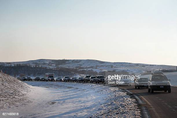Cars line the road waiting to enter Oceti Sakowin Camp on the edge of the Standing Rock Sioux Reservation on December 3, 2016 outside Cannon Ball,...