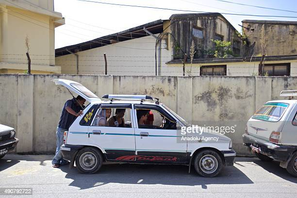 Cars line up as drivers wait for the opening of a fuel pump at a petrol station in Kathmandu on September 30 2015 Nepalese are facing an acute crisis...