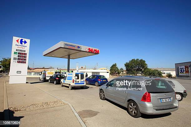 Cars line up at a gas station as Union workers continue their strike action on October 18 2010 in Berre France Some oil workers pledged to keep up a...